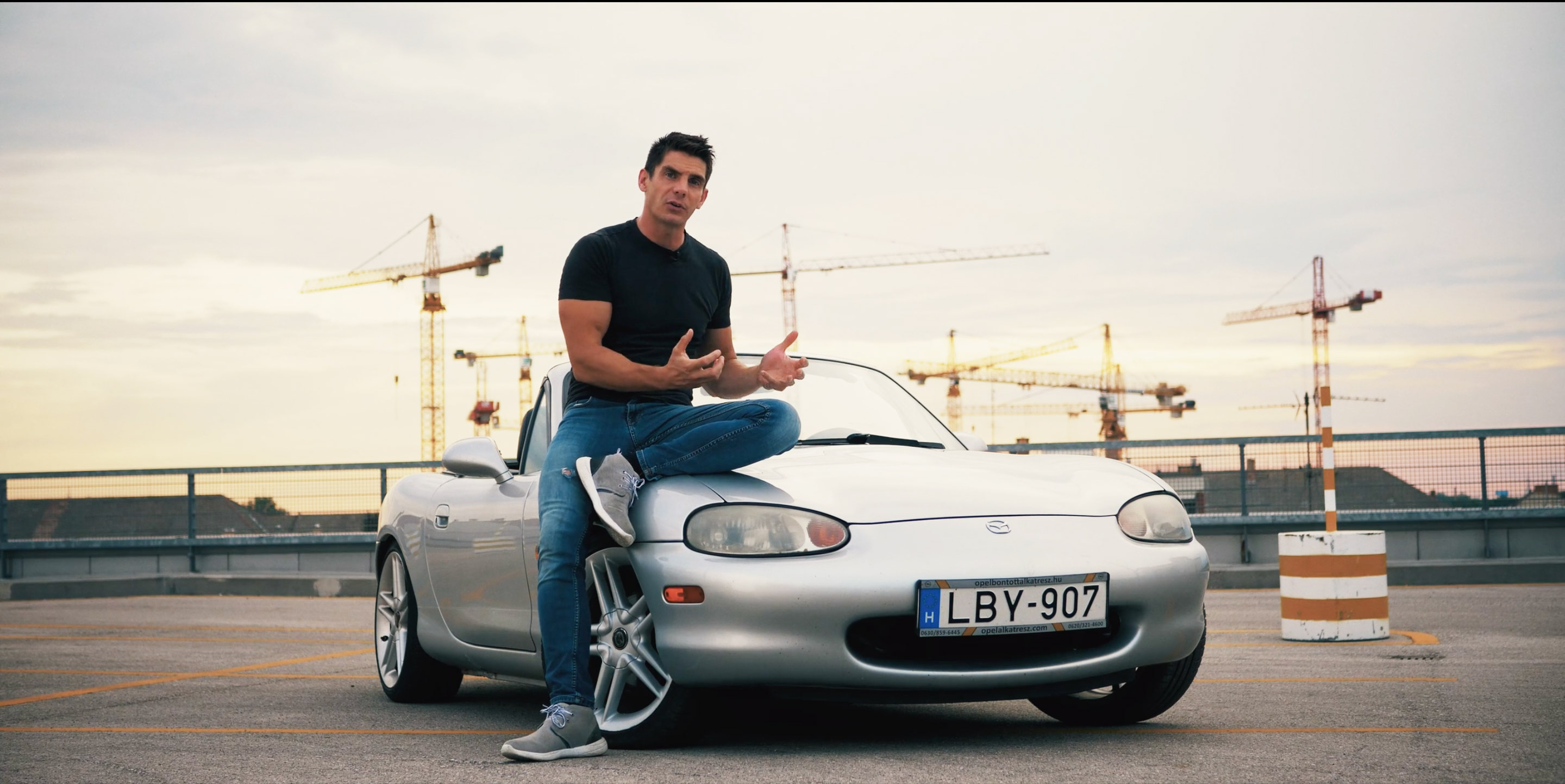 alex-muir-with-mx5-miata-on-roof