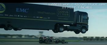 Lotus F1 team jump truck over race car
